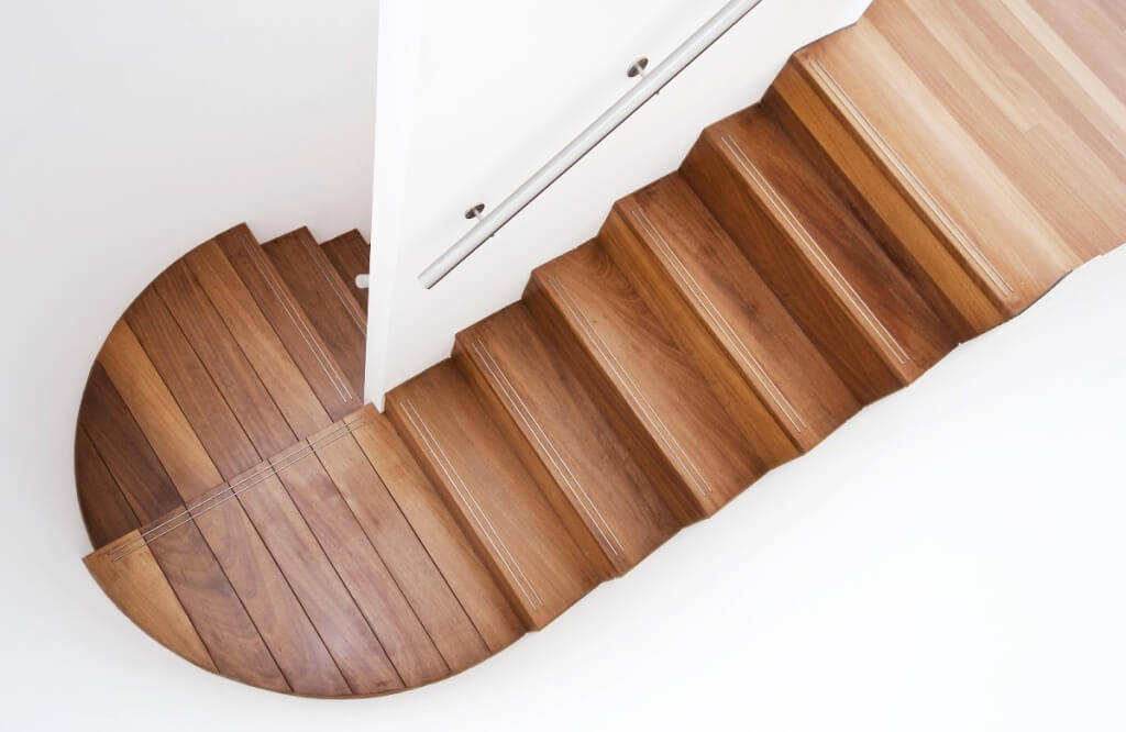 Organic Modern Design wooden staircase with curved landing wall